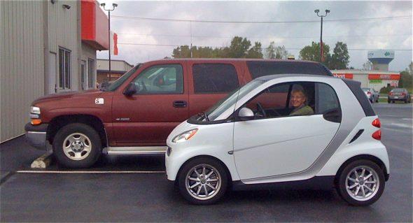 Smart Car next to Suburban